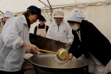Volunteers cooking hot meals in the Evacuation center in Aizuwakamatsu city, Fukushima