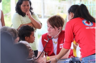 French Red Cross doctor Aleth Abidine examines local patients at a mobile clinic. Dozens of patients visited the clinic in a two-hour period.